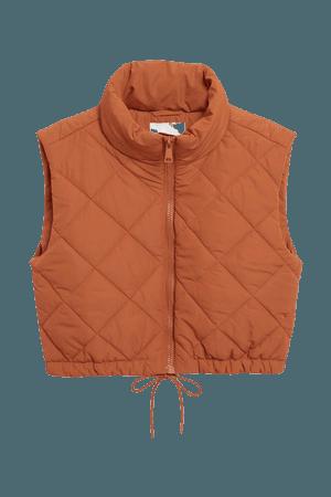 Cropped puffer vest - Dark orange - Jackets - Monki WW