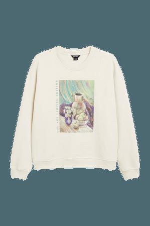 Crewneck sweater - Beige with front print - Sweatshirts - Monki WW