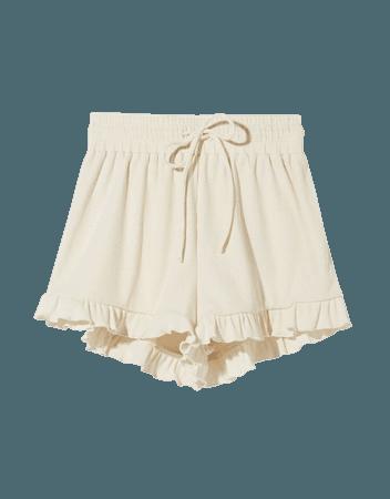 Ribbed shorts with ruffles - Pants - Woman | Bershka