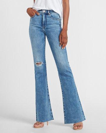 High Waisted Ripped Raw Hem Slim Flare Jeans