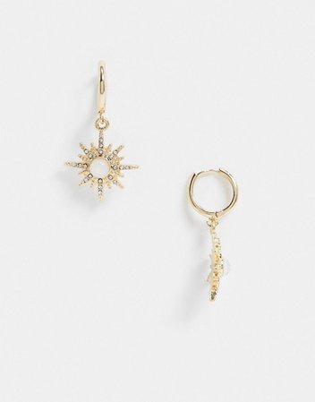 ASOS DESIGN hoop earrings with starburst charm in gold tone | ASOS