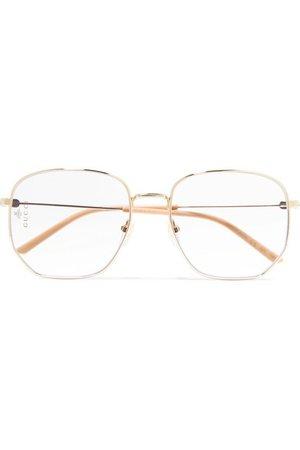 Gucci | Hexagon-frame gold-tone and acetate optical glasses | NET-A-PORTER.COM