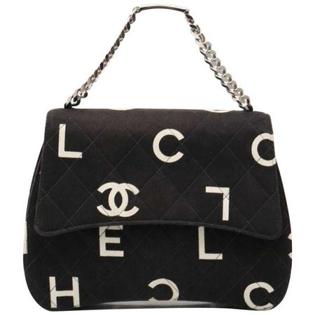 Vintage CHANEL black canvas handbag with silver chain strap and white logo print For Sale at 1stdibs
