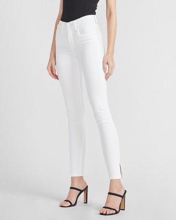 Mid Rise White Slit Hem Skinny Jeans