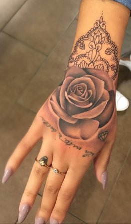 rings, nails, rose hand tattoo