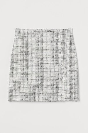 Bouclé mini skirt - Light beige/Black checked - Ladies   H&M