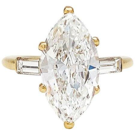 Cartier 3.15 Carat Marquise Cut Diamond Gold Ring For Sale at 1stdibs