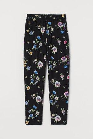 Pantaloni pull-on - Nero/fiori - DONNA   H&M IT