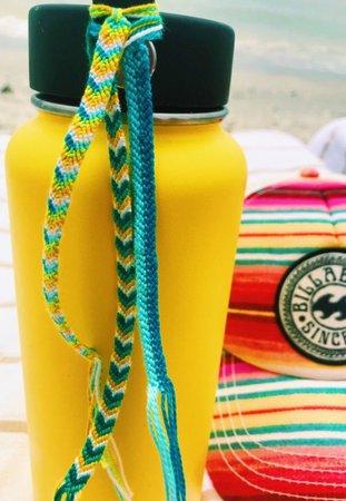 friendship bracelets on yellow hydro flask