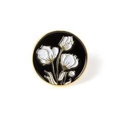 Black and white flower enamel pin