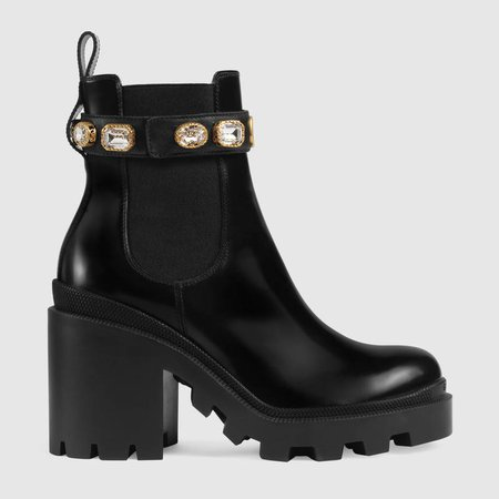 Black leather ankle boot with belt