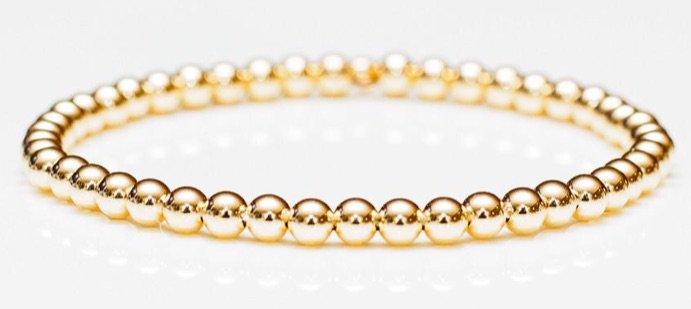 Gold stretch bracelet by Belle & Ten