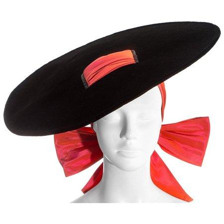 Yves Saint Laurent black velvet saucer hat with orange taffeta ribbon, fw 1995 For Sale at 1stdibs