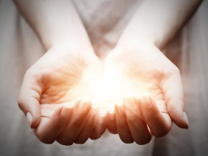 Cupped hands held together and holding a luminous ball of light   Singing For Your Soul