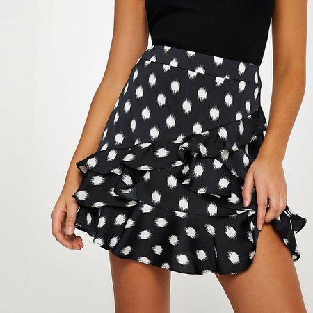 Black spot frill detail mini skirt   River Island