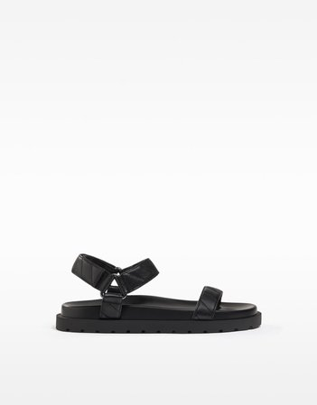 Flat sandals with quilted straps - Shoes - Woman | Bershka