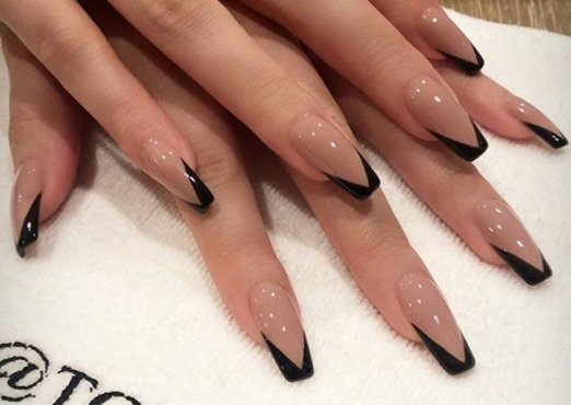 nude with black tip nails