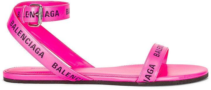 Round Flat Sandals in Neon Pink & Black | FWRD