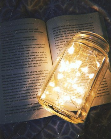 book and fairy lights