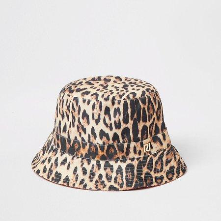 Brown printed reversible bucket hat | River Island