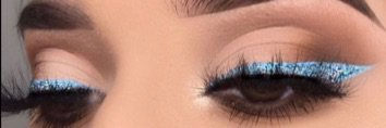 Blue Glitter Winged Eye Makeup