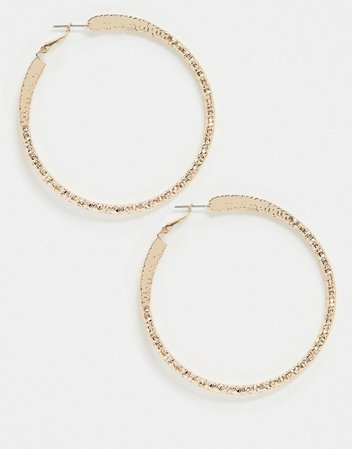 ASOS DESIGN hoop earrings with pinched texture design in gold tone | ASOS