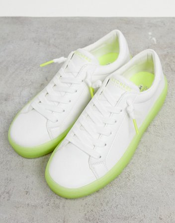 Skechers lace up sneakers in white with green sole | ASOS