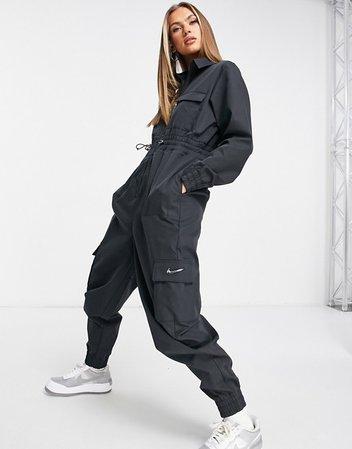 Nike Swoosh utility jumpsuit in black   ASOS