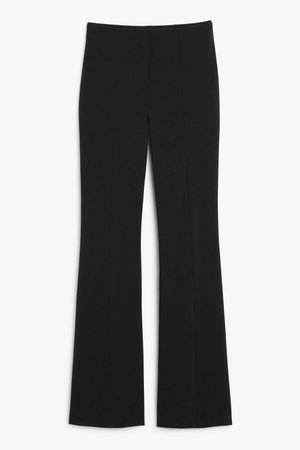 High-waist flared trousers - Black - Trousers - Monki WW