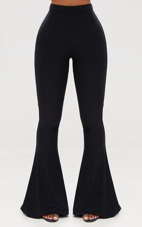 Shape Black Slinky Flared Leg Pants | PrettyLittleThing USA