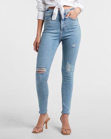 Super High Waisted Medium Wash Ripped Raw Hem Skinny Jeans