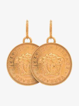 Versace metallic Tribute Medusa pendant earrings | Earrings | Browns