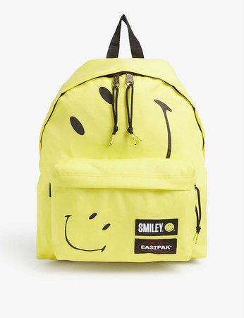 EASTPAK - Eastpak X Smiley Pak'r padded backpack | Selfridges.com