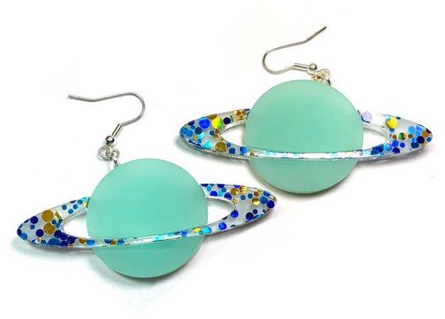 kitschy planet earrings