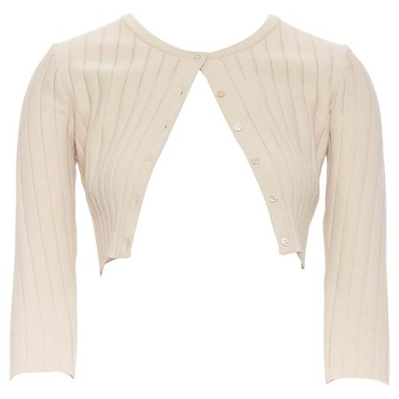 ALAIA nude ladder stitch button front 3/4 sleeves cropped cardigan FR36 For Sale at 1stdibs