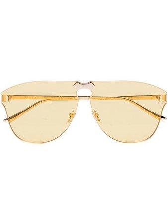 Gucci Eyewear yellow aviator-frame rimless sunglasses