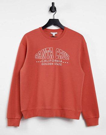 Topshop oversized 'santa cruz' sweatshirt in rust   ASOS