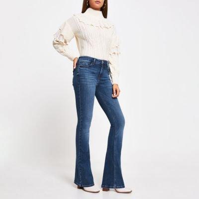 Blue Amelie flared jeans hands | River Island