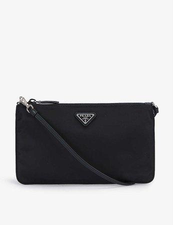 PRADA - Logo-plaque nylon shoulder bag | Selfridges.com