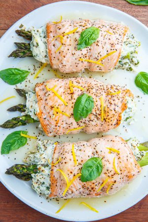 Asparagus and Lemon and Basil Ricotta Stuffed Salmon Rolls with Lemon Sauce food