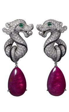 silver dragon earrings with purple gems