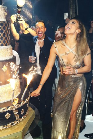 Jennifer Lopez dazzles in $15K Versace dress on 50th birthday