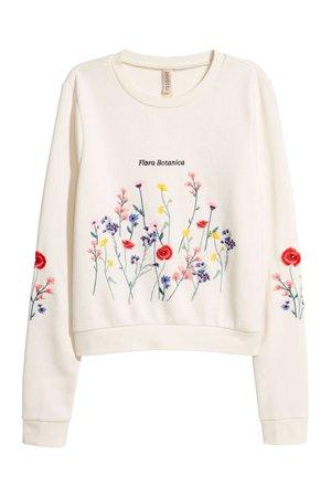 Embroidered sweatshirt - Cream/Flowers - Ladies | H&M