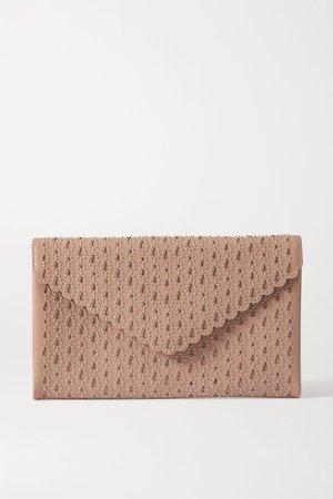 Beige Studded laser-cut leather clutch   Alaïa   NET-A-PORTER