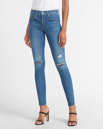 Mid Rise Hyper Stretch Ripped Raw Hem Skinny Jeans