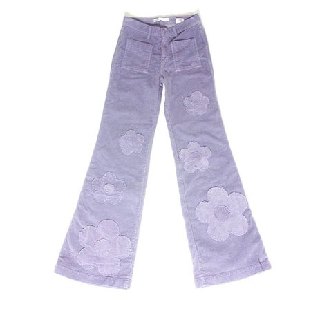 Lilac flared corduroy high waisted trousers. Hand stitched daisy/flower frayed edge patches