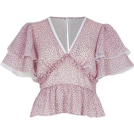 Pink spot print frill blouse | River Island