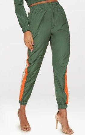 Khaki Stripe Shell Suit Jogger | Trousers | PrettyLittleThing