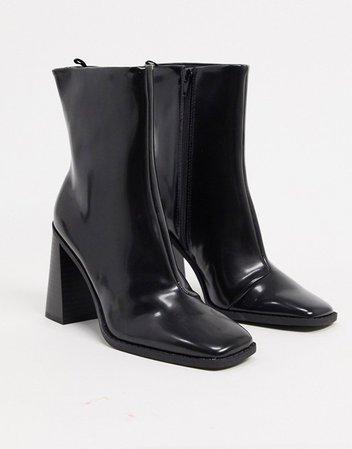 Monki Robbie vegan-friendly leather heeled boot in black | ASOS