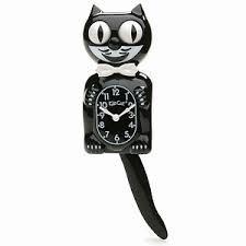 cat clock creepy - Google-søgning
